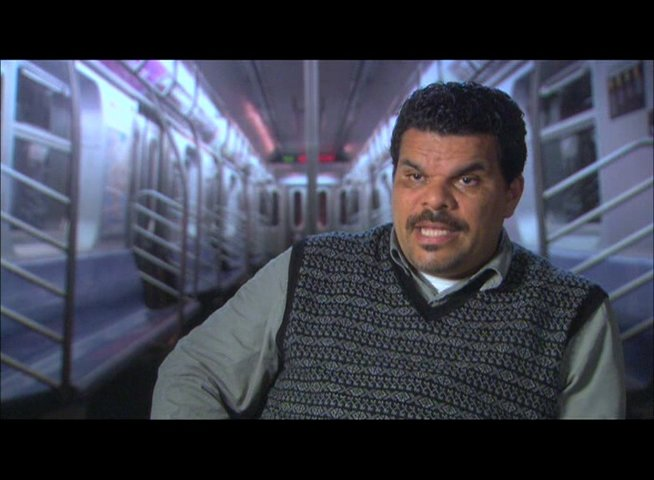 "Luis Guzman (""Phil Ramos"") über Tony Scott - OV-Interview Poster"