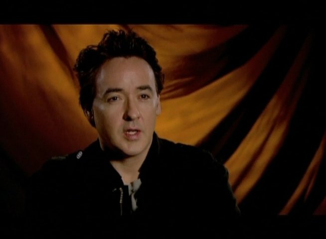 Interview mit John Cusack (Stanley Philipps) - OV-Interview Poster