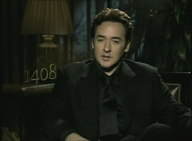 Interview mit John Cusack ( Mike Enslin ) - OV-Interview Poster