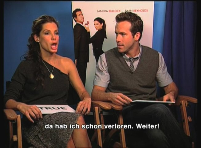 Sandra Bullock und Ryan Reynolds im Quiz. - Interview Poster